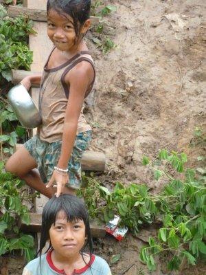 Children on the riverside in Battambang